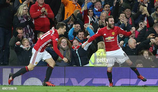 Juan Mata and Ander Herrera of Manchester United celebrate Paul Pogba scoring their second goal during the Premier League match between Manchester...