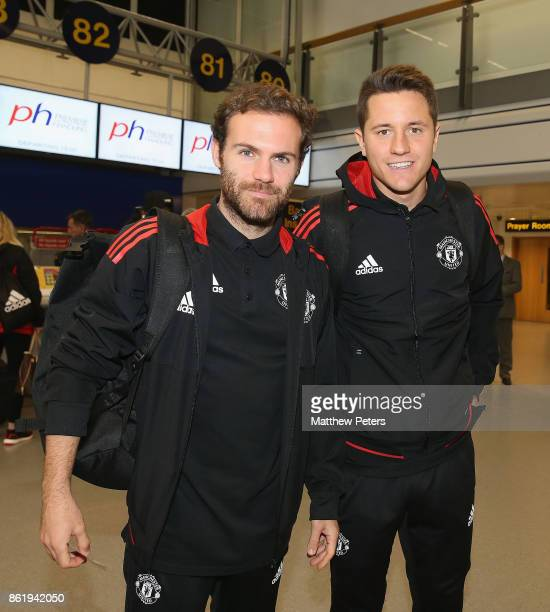 Juan Mata and Ander Herrera of Manchester United check in ahead of their flight to Lisbon for the UEFA Champions League match against Benfica at...