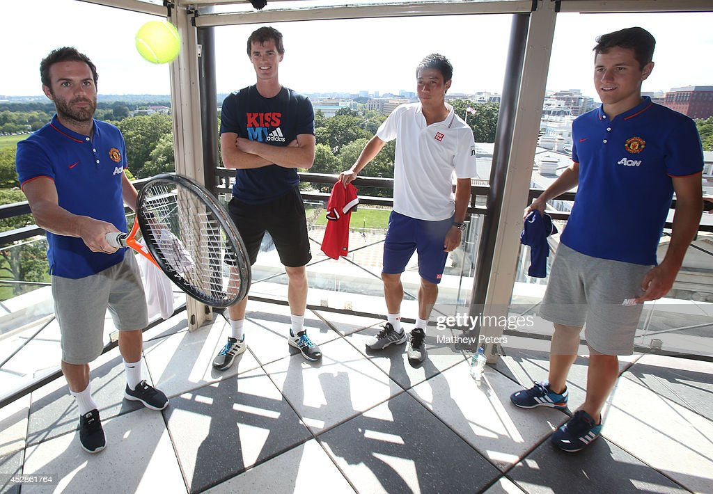 (MINIMUM PRINT/BROADCAST FEE OF GBP 150, ONLINE FEE OF GBP 75 PER IMAGE, OR LOCAL EQUIVALENT) Juan Mata and Ander Herrera of Manchester United meet tennis players Kei Nishikori and Jamie Murray who are playing in the Citi Open, at their hotel on July 28, 2014 in Washington, DC.
