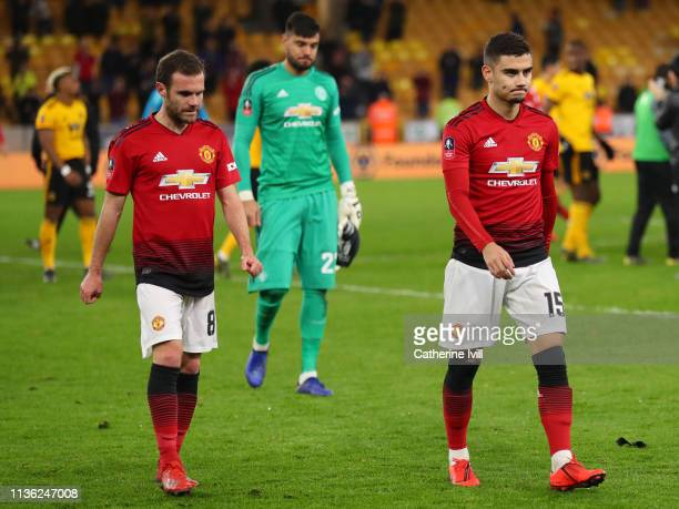 Juan Mata and Andreas Pereira of Manchester United leave the pitch following defeat in the FA Cup Quarter Final match between Wolverhampton Wanderers...