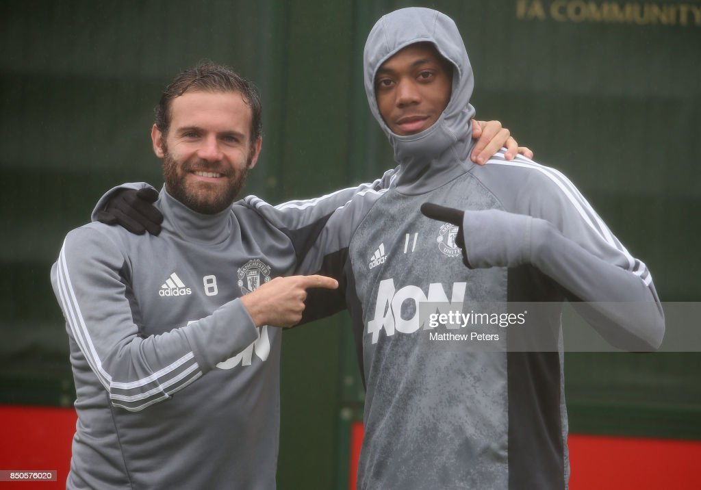 Juan Mata and Anthony Martial of Manchester United in action during a first team training session at Aon Training Complex on September 21, 2017 in Manchester, England.