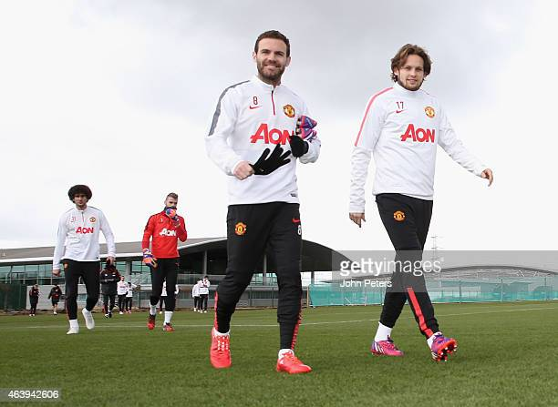 Juan Mata and Daley Blind of Manchester United walk out ahead of a first team training session at Aon Training Complex on February 20 2015 in...