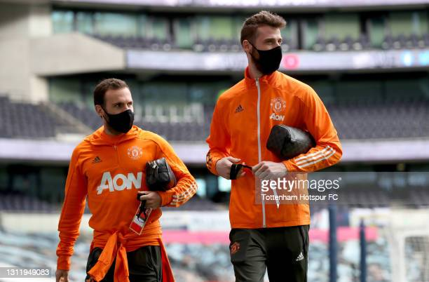 Juan Mata and David de Gea of Manchester United are seen wearing a face covering as they arrive at the stadium prior to the Premier League match...