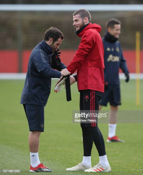 Juan Mata and David de Gea of Manchester United in action during a first team training session ahead of the UEFA Champions League Group H match...