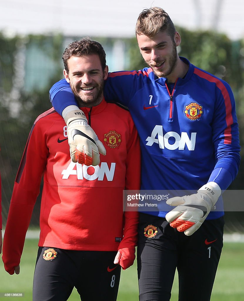 Juan Mata and David de Gea of Manchester United in action during a first team training session at Aon Training Complex on September 26, 2014 in Manchester, England.
