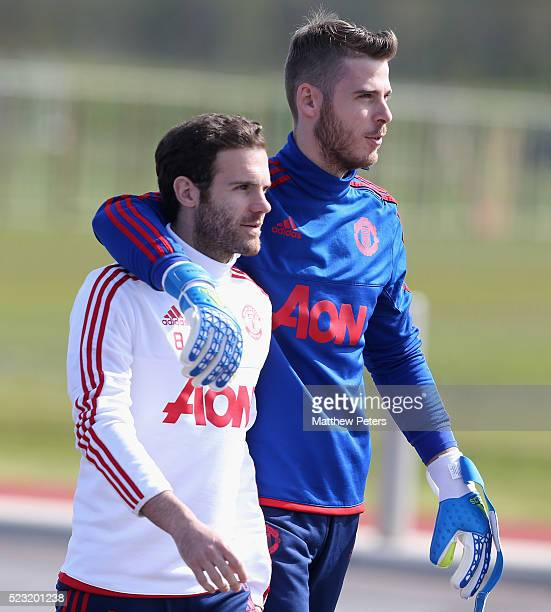 Juan Mata and David de Gea of Manchester United in action during a first team training session at Aon Training Complex on April 22 2016 in Manchester...