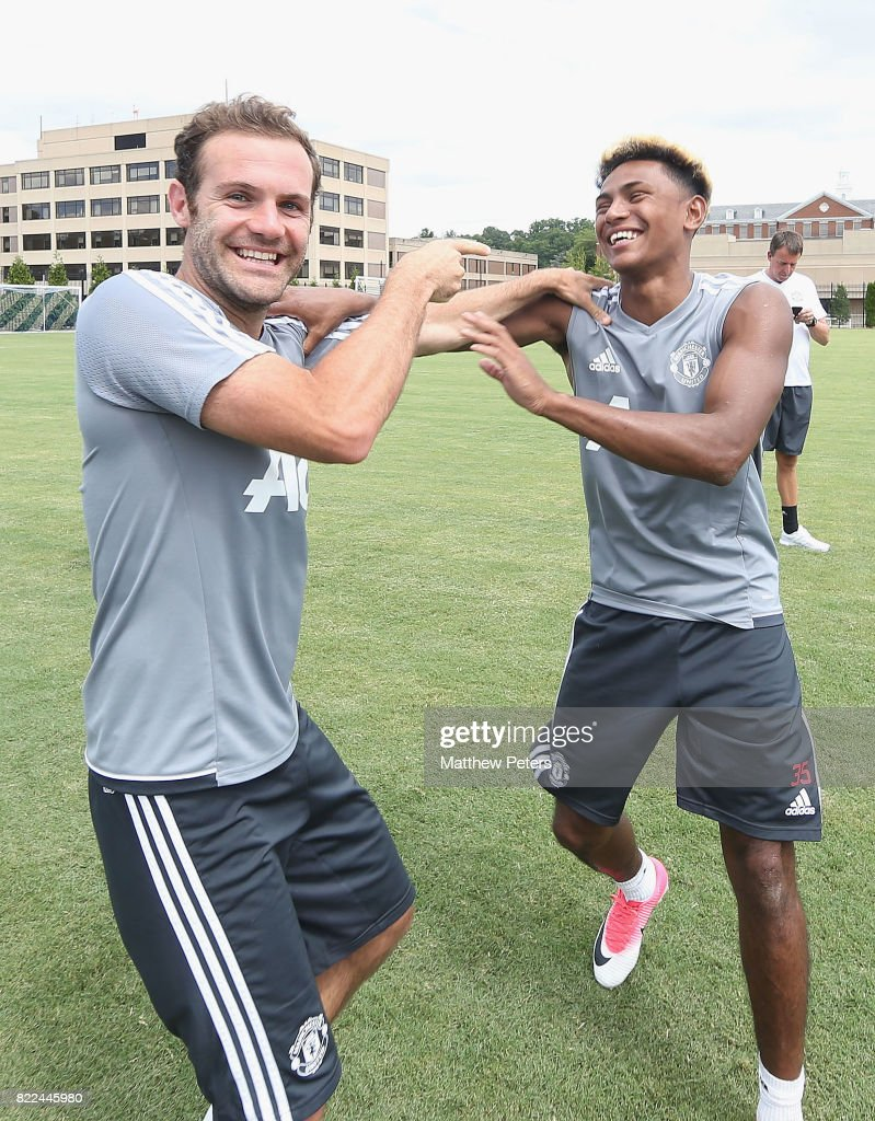 Juan Mata and Demitri Mitchell of Manchester United in action during a first team training session as part of their pre-season tour of the USA on July 25, 2017 in Washington, DC.