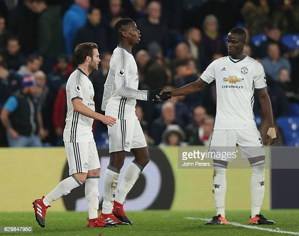 Juan Mata and Eric Bailly of Manchester United celebrate Paul Pogba scoring their first goal during the Premier League match between Crystal Palace...