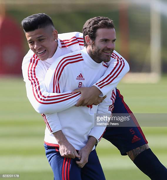 Juan Mata and Marcos Rojo of Manchester United in action during a first team training session at Aon Training Complex on April 22 2016 in Manchester...