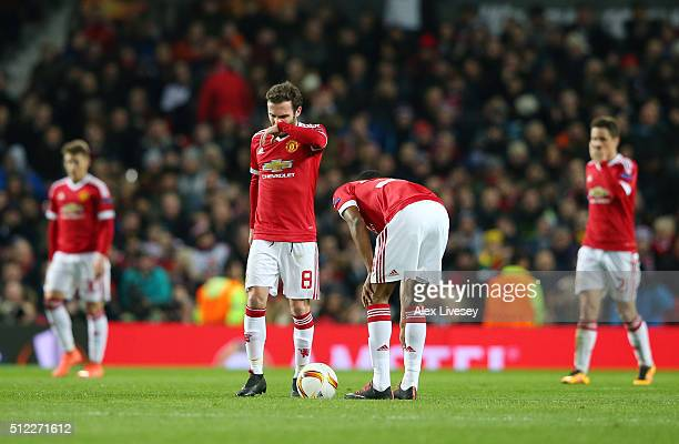 Juan Mata and Marcus Rashford of Manchester United show their dejection after Midtjylland's first goal during the UEFA Europa League Round of 32...