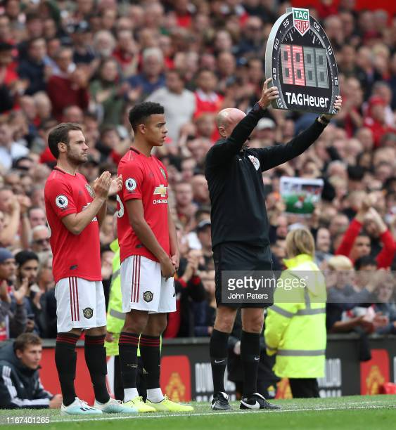Juan Mata and Mason Greenwood of Manchester United come on as substitutes during the Premier League match between Manchester United and Chelsea FC at...