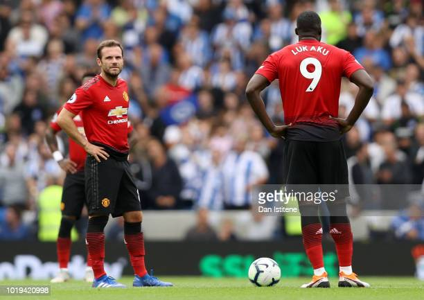 Juan Mata and Romelu Lukaku of Manchester United look on following Brighton and Hove Albion's second goal during the Premier League match between...