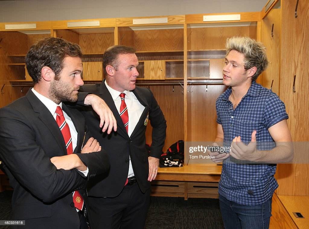 (MINIMUM PRINT/BROADCAST FEE OF GBP 150, ONLINE FEE OF GBP 50 PER IMAGE, OR LOCAL EQUIVALENT) Juan Mata and Wayne Rooney of Manchester United talk with Niall Horan of pop group One Direction after the International Champions Cup 2015 match between Manchester United and Paris Saint Germain at Soldier Field on July 29, 2015 in Chicago, Illinois.