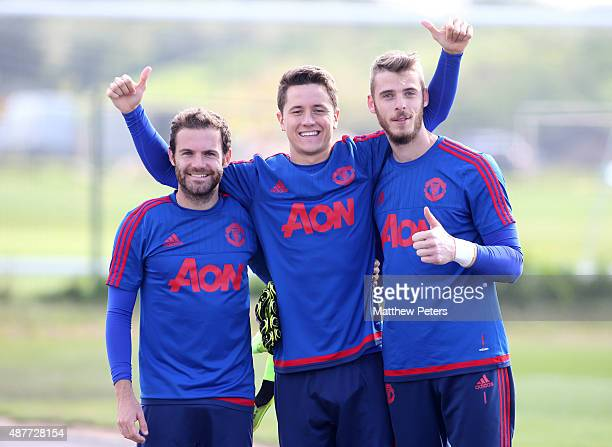 Juan Mata, Ander Herrera and David de Gea of Manchester United in action during a first team training session at Aon Training Complex on September...