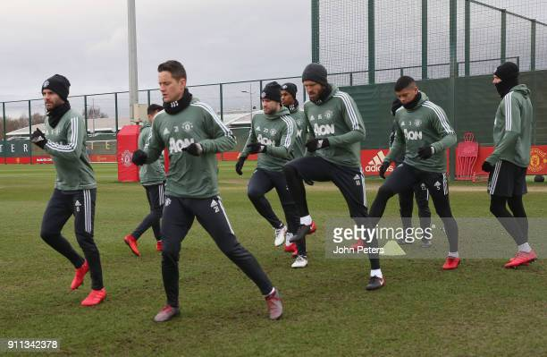 Juan Mata Ander Herrera Michael Carrick and Marcos Rojo of Manchester United in action during a first team training session at Aon Training Complex...
