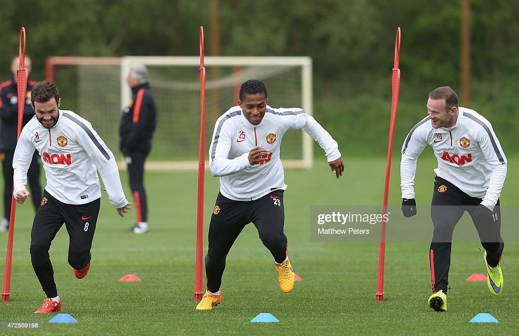 Juan Mata, Antonio Valencia and Wayne Rooney of Manchester United in action during a first team training session at Aon Training Complex on May 8, 2015 in Manchester, England.