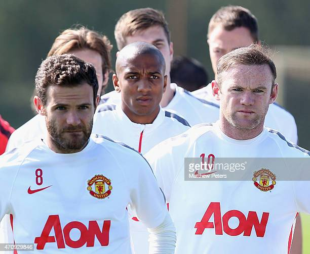 Juan Mata Ashley Young and Wayne Rooney of Manchester United in action during a first team training session at Aon Training Complex on April 24 2015...