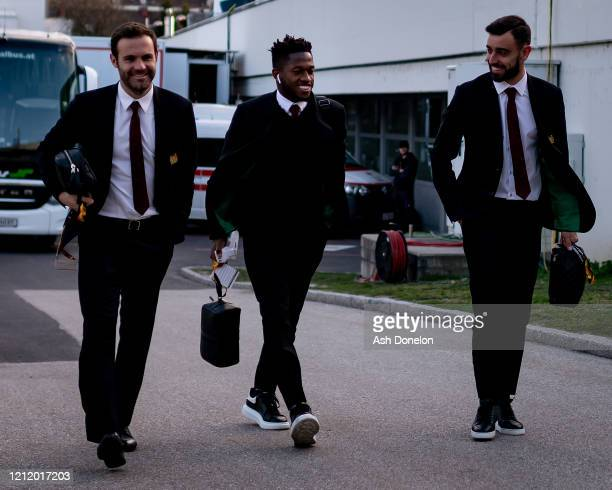 Juan Mata Fred and Bruno Fernandes of Manchester United arrive ahead of the UEFA Europa League round of 16 first leg match between LASK and...