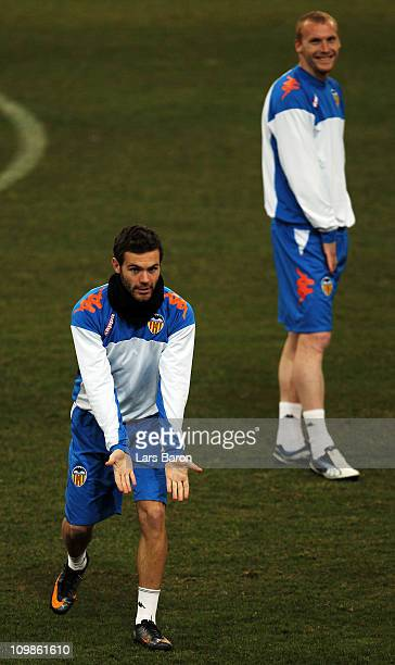 Juan Mata gestures during a FC Valencia training session ahead of the UEFA Champions League Round of 16 second leg match against FC Schalke 04 at...