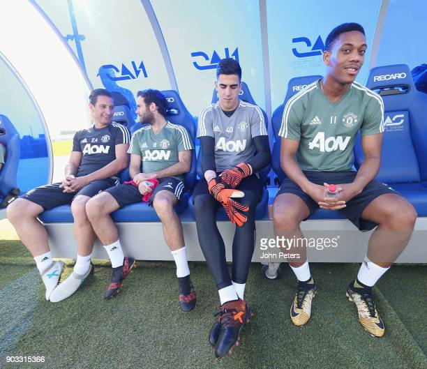 Juan Mata Joel Pereira and Anthony Martial of Manchester United in action during a first team training session at Nad Al Sheba Sports Complex on...