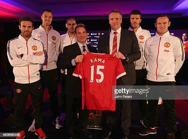 Juan Mata Jonny Evans Victor Valdes Michael Carrick and Wayne Rooney of Manchester United pose with Head of Marketing Jonathan Rigby and CEO of...