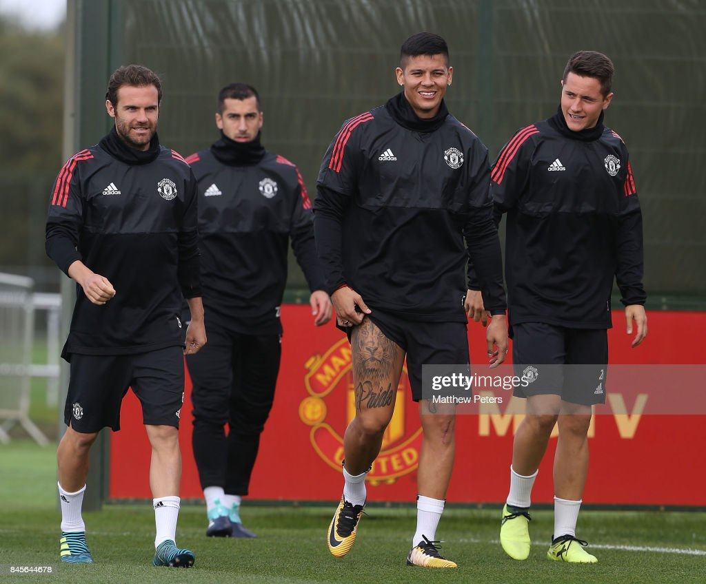 Juan Mata, Marcos Rojo and Ander Herrera of Manchester United in action during a first team training session at Aon Training Complex on September 11, 2017 in Manchester, England.