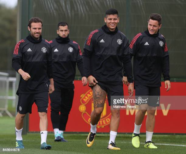 Juan Mata Marcos Rojo and Ander Herrera of Manchester United in action during a first team training session at Aon Training Complex on September 11...