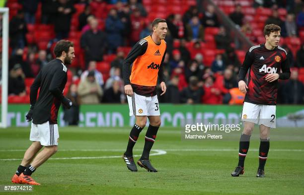 Juan Mata Nemanja Matic and Victor Lindelof of Manchester United warm up ahead of the Premier League match between Manchester United and Brighton and...