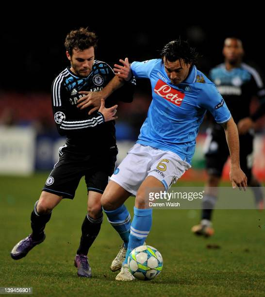 Juan Mata of Chelsea and Salvatore Aronica of Napoli compete for the ball during the UEFA Champions League round of 16 first leg match between SSC...