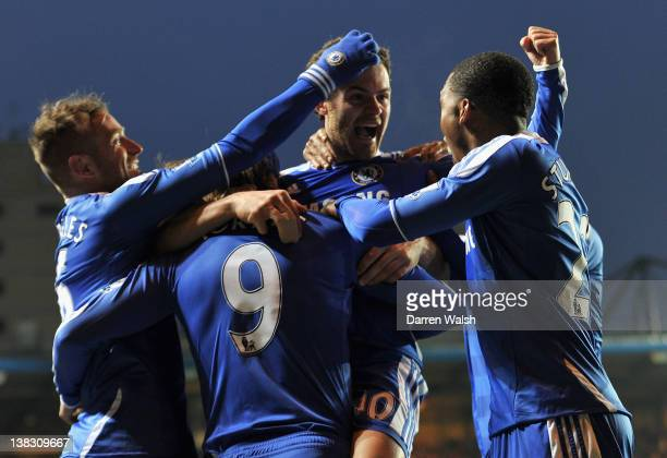 Juan Mata of Chelsea celebrates scoring his side's second goal with team mates Raul Meireles Fernando Torres and Daniel Sturridge during the Barclays...