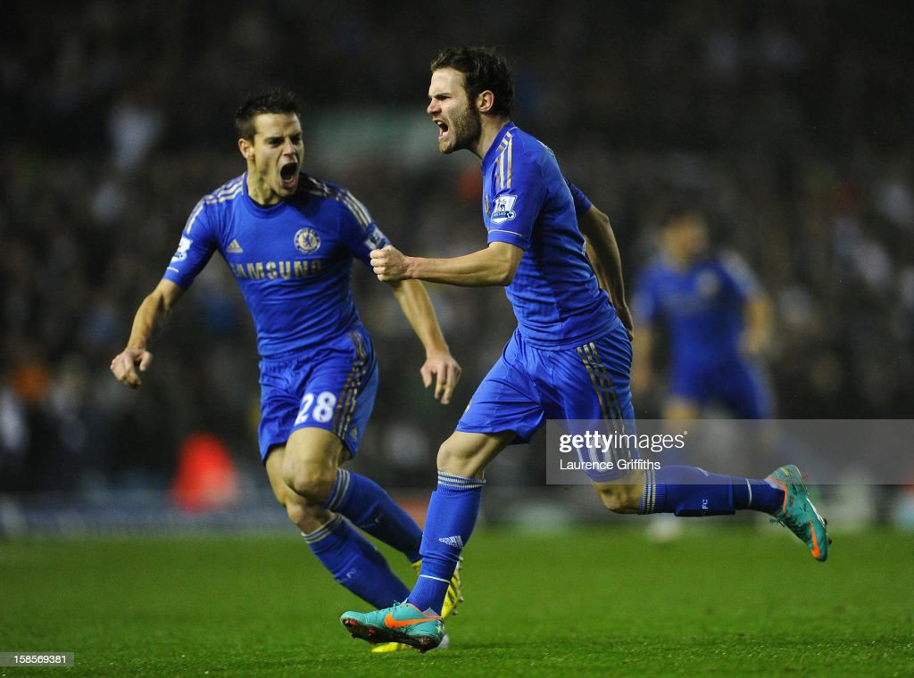 Juan Mata of Chelsea celebrates scoring his team's first goal to make the score 1-1 with team-mate Cesar Azpilicueta (L) during the Capital One Cup Quarter-Final match between Leeds United and Chelsea at Elland Road on December 19, 2012 in Leeds, England.
