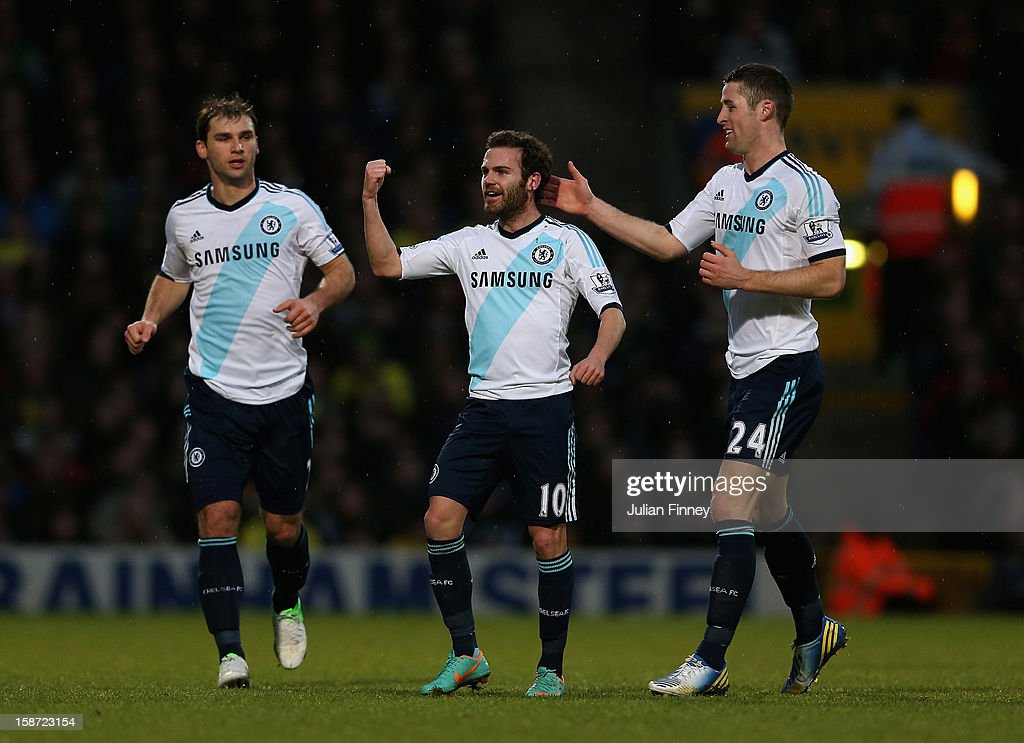 Juan Mata of Chelsea celebrates scoring the first goal with team mate Gary Cahill of Chelsea during the Barclays Premier League match between Norwich City and Chelsea at Carrow Road on December 26, 2012 in Norwich, England.