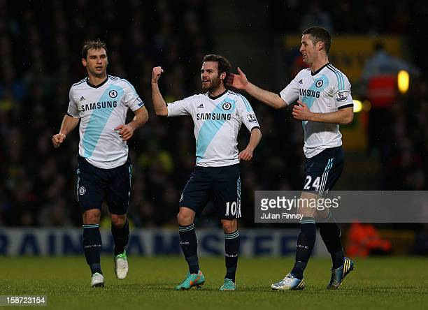 Juan Mata of Chelsea celebrates scoring the first goal with team mate Gary Cahill of Chelsea during the Barclays Premier League match between Norwich...