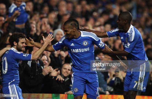 Juan Mata of Chelsea celebrates with Florent Malouda and Fernando Torres as he scores their first goal during the FA Cup sponsored by Budweiser Third...