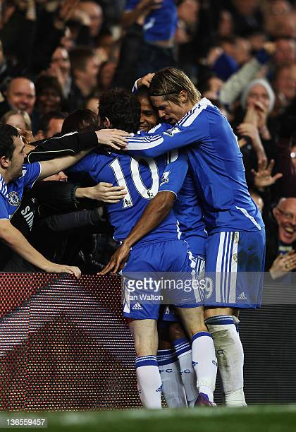 Juan Mata of Chelsea celebrates with Florent Malouda and Fernando Torres during the FA Cup sponsored by Budweiser Third Round match between Chelsea...