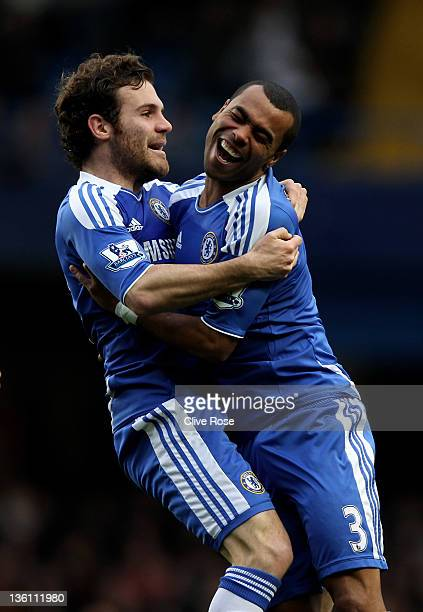 Juan Mata of Chelsea celebrates with teammate Ashley Cole after scoring the opening goal during the Barclays Premier League match between Chelsea and...