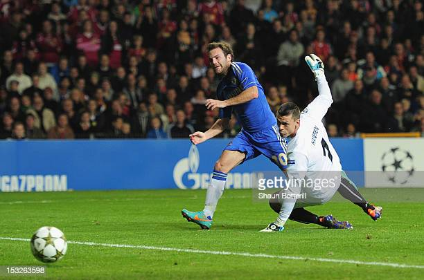Juan Mata of Chelsea fires the ball past Jesper Hansen of FC Nordsjaelland to score during the UEFA Champions League Group E match between FC...