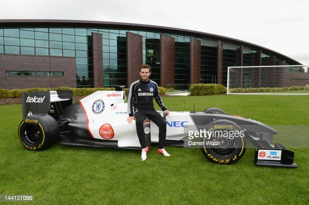 Juan Mata of Chelsea next to the Sauber F1 car to launch the Chelsea FC and Sauber partnership at the Cobham training ground on May 10 2012 in Cobham...