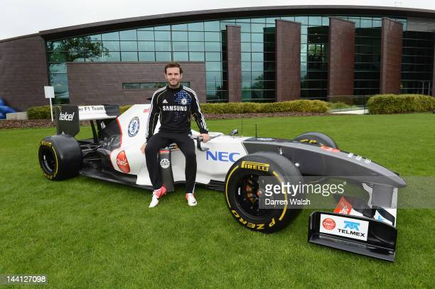 Juan Mata of Chelsea next to the Sauber F1 car to launch the Chelsea FC and Sauber partnership at the Cobham training ground on May 10, 2012 in...