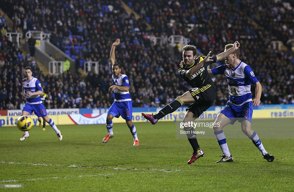 Juan Mata of Chelsea scores the opening goal during the Barclays Premier League match between Reading and Chelsea at Madejski Stadium on January 30, 2013 in Reading, England.