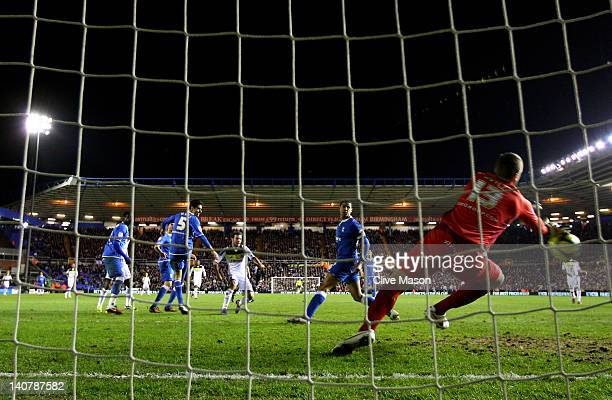 Juan Mata of Chelsea scores the opening goal during the FA Cup Fifth Round Replay match between Birmingham City and Chelsea at St Andrews on March 6...