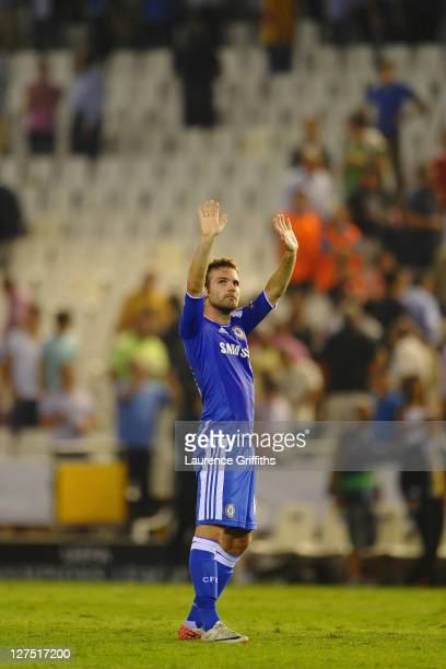 Juan Mata of Chelsea waves to the Valencia fans after the UEFA Champions League Group E match between Valencia CF and Chelsea at the Estadio Mestalla...