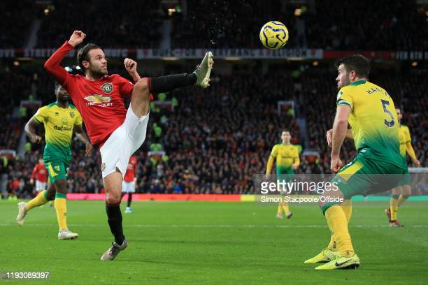 Juan Mata of Man Utd battles with Grant Hanley of Norwich during the Premier League match between Manchester United and Norwich City at Old Trafford...