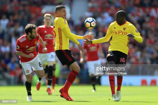 Juan Mata of Man Utd battles with Jose Holebas of Watford and Abdoulaye Doucoure of Watford during the Premier League match between Manchester United...