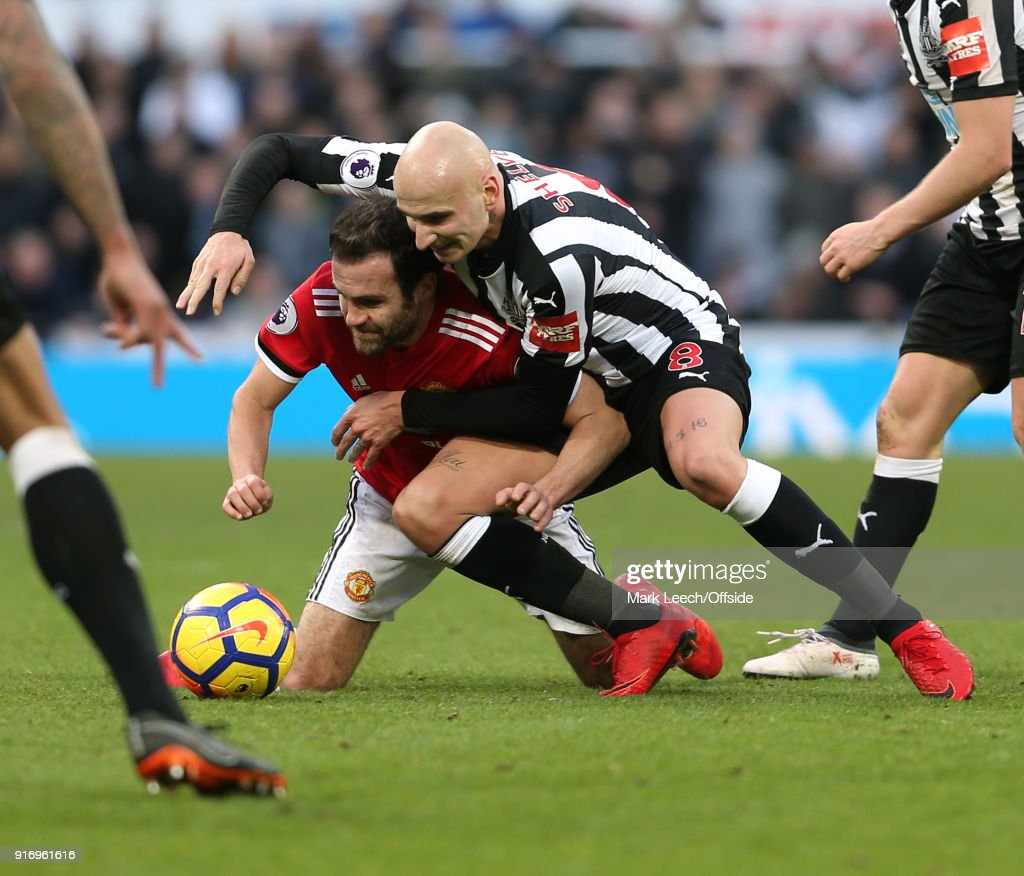 Juan Mata of Man Utd is tackled by Jonjo Shelvey of Newcastle during the Premier League match between Newcastle United and Manchester United at St. James Park on February 11, 2018 in Newcastle upon Tyne, England.