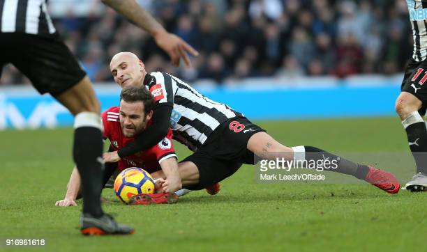 Juan Mata of Man Utd is tackled by Jonjo Shelvey of Newcastle during the Premier League match between Newcastle United and Manchester United at St...