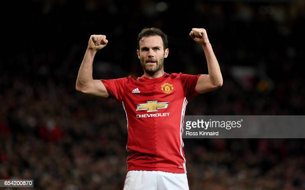 Juan Mata of Manchester celebrates after scoring the opening goal during the UEFA Europa League Round of 16 second leg match between Manchester...