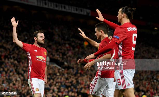 Juan Mata of Manchester is congratulated after scoring the opening goal during the UEFA Europa League Round of 16 second leg match between Manchester...
