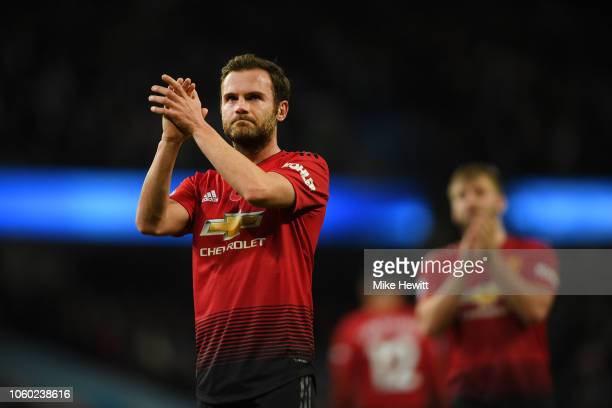 Juan Mata of Manchester United acknowledges the fans after the Premier League match between Manchester City and Manchester United at Etihad Stadium...
