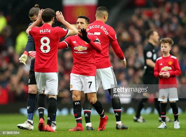 Juan Mata of Manchester United and Alexis Sanchez of Manchester United embrace prior to the Premier League match between Manchester United and...